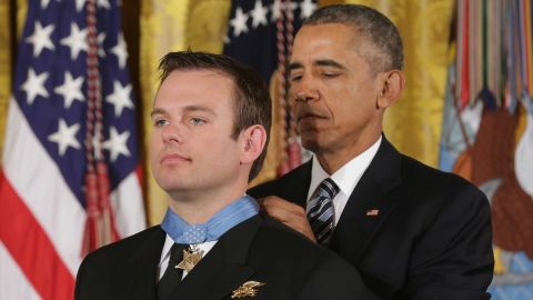 President Barack Obama presents Navy Senior Chief Edward Byers Jr., 36, with the Medal of Honor during a ceremony in the East Room of the White House February 29, 2016. A member of Navy SEAL Team 6, Byers received the Medal of Honor for his role in rescuing an American hostage from the Taliban in Afghanistan in December 2012.