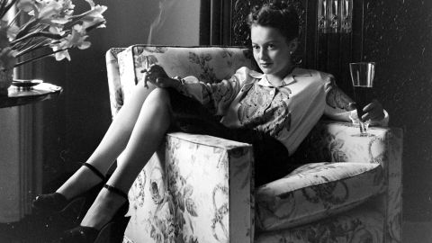 """<a href=""""http://www.cnn.com/2013/01/21/us/olivia-de-havilland-fast-facts/"""">Olivia de Havilland</a> remains one of the last survivors of Hollywood's glamorous heyday of the 1930s and '40s. The star celebrates her 100th birthday on Friday, July 1. De Havilland, the personification of kind and genteel ladies in the movies, initially wanted to be a schoolteacher. But she began acting professionally at 18 and enjoyed a career that spanned from the mid-'30s to the late '80s. Here, in an uncharacteristic pose, she relaxes at home with a cigarette and beer in the early 1940s."""