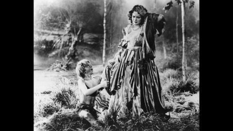 """De Havilland caught the acting bug in school plays as a teenager. She made her film debut as Hermia in Shakespeare's """"A Midsummer Night's Dream"""" (1935) after appearing in a successful production of the play at the Hollywood Bowl. Warner Bros. quickly signed the young actress to a film contract. <a href=""""http://time.com/57843/mickey-rooney-olivia-de-havilland/"""" target=""""_blank"""" target=""""_blank"""">De Havilland warmly recalled working with Mickey Rooney,</a> left, who played Puck in the film."""