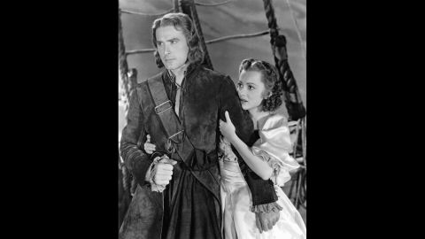 """The actress appeared in two other movies before """"A Midsummer Night's Dream"""" was even released, but she shot to stardom in her fourth film, """"Captain Blood"""" (1935), a swashbuckling adventure with Errol Flynn. The two became one of the great romantic screen teams of the 1930s and '40s, starring in eight films altogether. The actress later admitted to having a crush on her handsome co-star, but she refused to succumb to his roguish charms."""