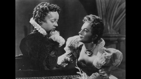 """Back at Warner Bros. after """"GWTW,"""" de Havilland had to play second fiddle to Bette Davis, left, in """"The Private Lives of Elizabeth and Essex"""" (1939). The two actresses would become good friends, and Davis hailed de Havilland's court victory against Warner as <a href=""""http://www.reuters.com/article/industry-lawsuit-dc-idUSN2329585820070824"""" target=""""_blank"""" target=""""_blank"""">a major win for actors.</a> The studio tried unsuccessfully to extend de Havilland's seven-year contract, but the courts ruled in her favor."""