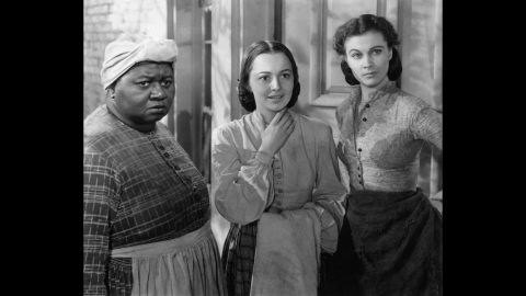 """Most actresses were dying to play Scarlett in the film of Margaret Mitchell's best-seller, """"Gone With the Wind,"""" but de Havilland, center, had her eyes on Melanie. The actress pushed for Warner Bros. to loan her out to producer David O. Selznick for his 1939 epic. She received the first of five Oscar nominations, losing to co-star Hattie McDaniel, left, as best supporting actress, while Vivien Leigh, as Scarlett, took home the best actress award. <a href=""""http://www.vanityfair.com/hollywood/2016/04/olivia-de-havilland-joan-fontaine-sibling-rivalry"""" target=""""_blank"""" target=""""_blank"""">De Havilland recently told Vanity Fair that McDaniel,</a> the first African-American to win an Oscar, """"was the best"""" and """"it was wonderful that she should win."""""""