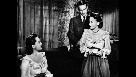 """De Havilland almost always played sympathetic parts, but her dual roles as twins in the thriller """"The Dark Mirror"""" (1946) proved to be an exception. Lew Ayres, center, was a psychiatrist trying to figure out which twin was a disturbed murderess."""
