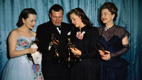 """The actress, far left, appears in the winners' circle with Harold Russell, Cathy O'Donnell and Anne Baxter at the Academy Awards in 1947. De Havilland won for """"To Each His Own,"""" while Russell picked up the best supporting actor Oscar and an honorary award for playing a disabled veteran in best picture winner """"The Best Years of Our Lives,"""" featuring O'Donnell as his girlfriend. Baxter, right, was best supporting actress for """"The Razor's Edge."""""""