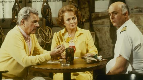 """De Havilland joined the parade of older stars who made guest appearances on the popular ABC TV series """"The Love Boat."""" Here, she appears with series star, Gavin MacLeod, right, and Joseph Cotten in a 1981 episode. The actress earlier had starred with Cotten in """"Hush ... Hush, Sweet Charlotte"""" (1964)."""