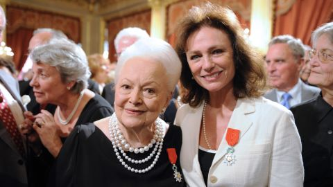"""De Havilland and fellow actress Jacqueline Bisset receive the Legion of Honor, one of France's top awards, at the Élysée Palace in Paris in September 2010. The """"Gone With the Wind"""" star has called the French capital home for six decades."""