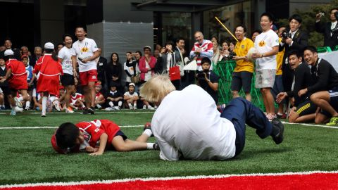 Johnson caused a stir when he knocked over a 10-year-old schoolboy while playing Rugby in Japan.
