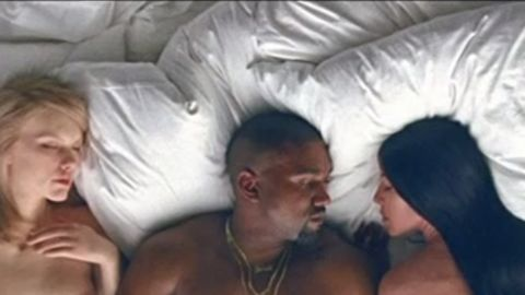 """In Kanye West's new video for """"Famous,"""" he appears in bed with likenesses of several celebrities, including Taylor Swift, left, and Kim Kardashian, West's wife."""