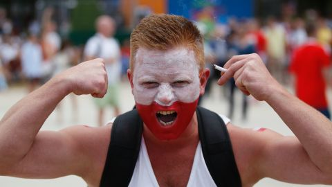 A Poland supporter cheers on his team.