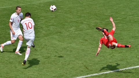 Shaqiri shoots to score on the volley in the 82nd minute.