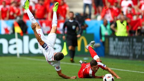 Fabian Schaer of Switzerland fouls Robert Lewandowski of Poland, resulting in a yellow card.