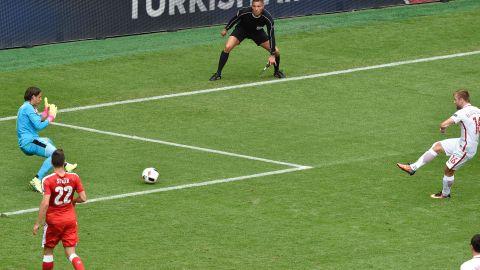 Poland midfielder Jakub Blaszczykowski, right, shoots to score past Switzerland goalkeeper Yann Sommer.