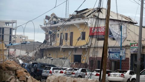 A view of the Nasahablod Hotel, destroyed after a bomb attack in Mogadishu, Somalia, Saturday, June 25, 2016. A Somali police officer says a suicide car bomber detonated an explosives-laden vehicle at the gate of a hotel in Mogadishu followed by gunmen who were fighting their way into the hotel..(AP Photo/Farah Abdi Warsameh)
