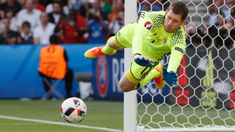 Northern Ireland goalkeeper Michael McGovern saves a shot.
