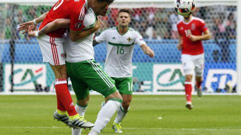 Wales defender James Chester, left, challenges Northern Ireland forward Kyle Lafferty.