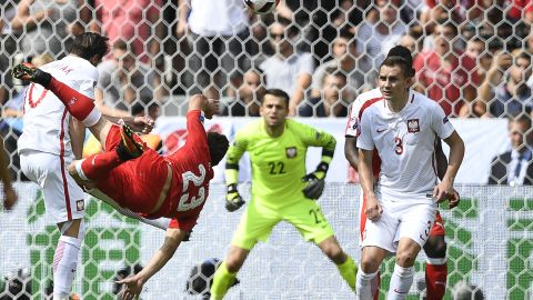 Switzerland's midfielder Xherdan Shaqiri scores with a spectacular overhead kick as his team drew level 1-1 with Poland in their Euro 2016 last 16 tie.