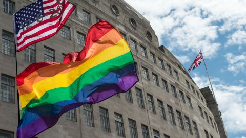 LONDON, ENGLAND - JUNE 25:  An American flag with the date of the Orlando shotings flies next to rainbow flags and a Union Jack behind as the LGBT community celebrates Pride in London on June 25, 2016 in London, England. Across the city performances and speeches take place as a parade makes it way through the centre ending in Trafalgar Square. 2016 Pride in London comes just two weeks after Omar Mateen shot dead 50 people at Pulse, a gay nightclub in Orlando, Florida.  (Photo by Chris J Ratcliffe/Getty Images)