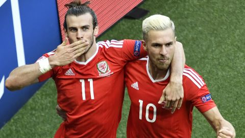 Gareth Bale (left) and midfielder Aaron Ramsey celebrate after an own goal by Northern Ireland's defender Gareth McAuley put their side ahead at the Parc des Princes.