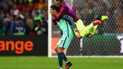 Eduardo jumps to his teammate Cristiano Ronaldo as Portugal celebrates their 1-0 win over Croatia on Saturday, June 25, 2016 at the Bollaert-Delelis stadium in Lens, France.