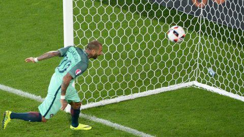 Portugal forward Ricardo Quaresma heads the ball to score a goal in extra time.