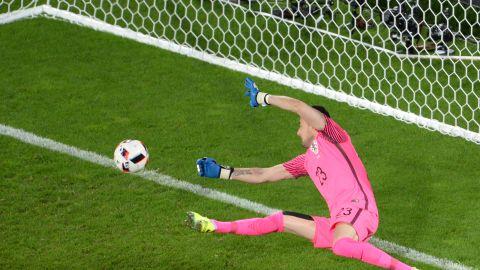Croatia goalkeeper Danijel Subasic tries to stop Portugal's goal in extra time.