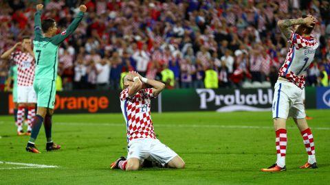 Domagoj Vida, center, of Croatia reacts after his shot goes wide.