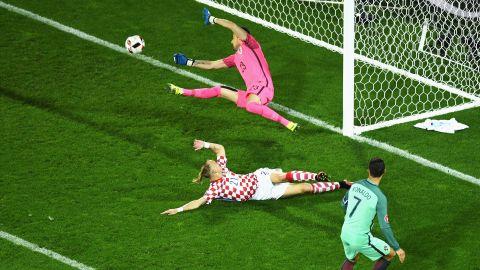 Cristiano Ronaldo, right, of Portugal shoots for a goal, but Croatia's Danijel Subasic makes the save.