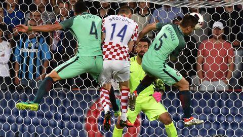 Croatia midfielder Marcelo Brozovic, second left, vies with Portugal defenders Jose Fonte, left, and Raphael Guerreiro, right, in front of Portugal goalkeeper Rui Patricio.