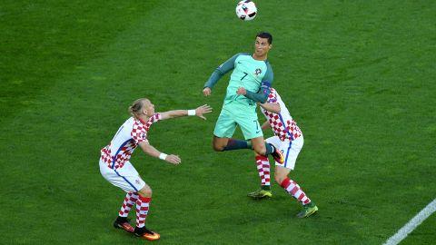 Cristiano Ronaldo, center, of Portugal heads the ball under pressure of Domagoj Vida, left, and Ivan Strinic, right, of Croatia.