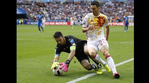 Italian goalkeeper Gianluigi Buffon snatches a ball away from Spain's Aritz Aduriz.