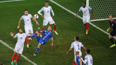 Iceland's Ragnar Sigurdsson attempts an overhead kick in the English box. His goal in the sixth minute tied the match at 1-1.