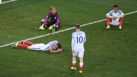 Wayne Rooney walks over to console his teammates -- from left, Gary Cahill, Joe Hart and Dele Alli -- after England were upset 2-1 by Iceland on Monday, June 27. Iceland will play France in the tournament's quarterfinals. England has been eliminated.