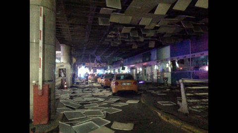 One of the bombs was located just outside the international terminal on the pavement, Turkish Justice Minister Bekir Bozdag told CNN. Another was at the security gate at the entrance to the airport.