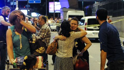 Passengers cry as they leave the airport.