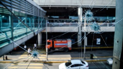 Bullet holes are seen at the airport on Wednesday, June 29.