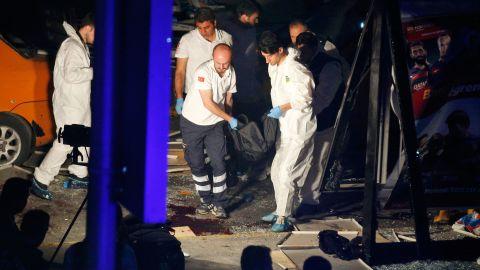 Investigators remove a body after the attack.