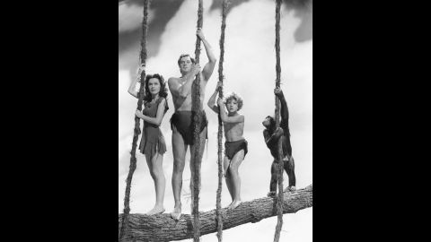 """Here he is, the classic Hollywod Tarzan: Olympic swimming champion-turned-actor Johnny Weissmuller in 1941's """"Tarzan's Secret Treasure,"""" also starring Maureen O'Sullivan as Jane and Johnny Sheffield as Boy. Weissmuller appeared in a dozen Tarzan films, first for MGM, then RKO. He <a href=""""https://www.youtube.com/watch?v=MwHWbsvgQUE"""" target=""""_blank"""" target=""""_blank"""">owns the classic Tarzan yell.</a>"""