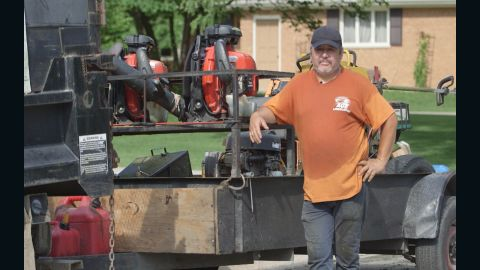 Alfredo Gamez sends home money he earns from his landscaping business.