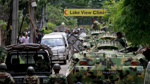 Bangladesh security personnel patrol the streets of Dhaka on Saturday, July 2, after gunmen seized a bakery in the capital overnight, killing 20 hostages and two officers, according to the military.