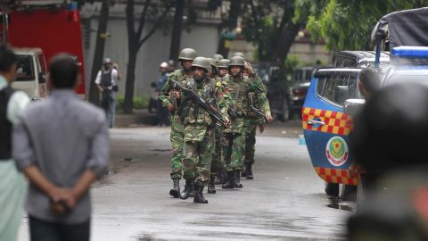 Bangladeshi soldiers come out of an area housing a restaurant popular with foreigners after heavily armed militants attacked it on Friday night and took dozens of hostages, in a diplomatic zone of the Bangladeshi capital Dhaka, Bangladesh, Saturday, July 2, 2016. The Islamic State group claimed responsibility for the attack on the Holey Artisan Bakery in Dhaka's Gulshan area, according to the SITE Intelligence Group, which monitors jihadis activity online. (AP Photo)