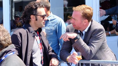 Four-time IndyCar Series champion Dario Franchitti (left) in conversation before Saturday's race. Franchitti works as TV co-commentator on the all electric race series.