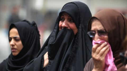 Iraqi women react on July 4 at the site of a suicide-bombing attack which took place a day earlier in Baghdad's busy shopping Karrada neighborhood. More than 200 people killed by a jihadist-claimed suicide car bombing that was among the deadliest ever attacks in the country.