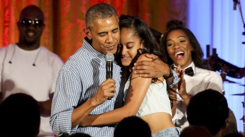 """Obama hugs Malia at the White House Fourth of July party in 2016. She was <a href=""""http://www.cnn.com/2016/07/05/politics/obama-malia-birthday-singing/"""">celebrating her 18th birthday</a> during the party, which included musicians Janelle Monae and Kendrick Lamar."""