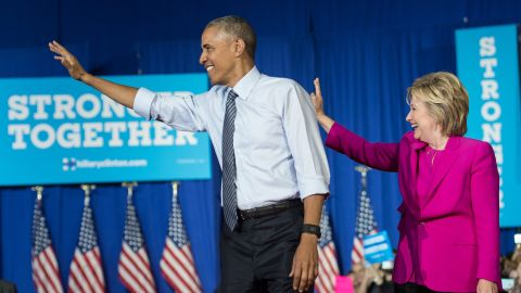 US President Barack Obama and Democratic presidential candidate Hillary Clinton arrive at a campaign event in Charlotte, North Carolina, on July 5, 2016. / AFP / NICHOLAS KAMM        (Photo credit should read NICHOLAS KAMM/AFP/Getty Images)