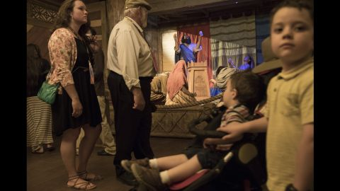 Visitors view a diorama of Moses and his family inside the ark.