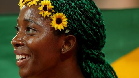 """Shelly-Ann Fraser-Pryce won world championship gold in 2015 with flowers in her hair and green braids. What's the plan for Rio? """"I haven't made up my mind but I'm loving blue right now...""""<br />"""