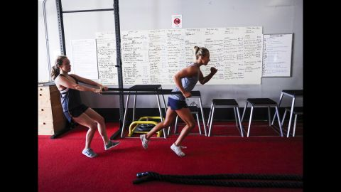 Koroleva, right, does exercises with U.S. team member Phoebe Coffin.