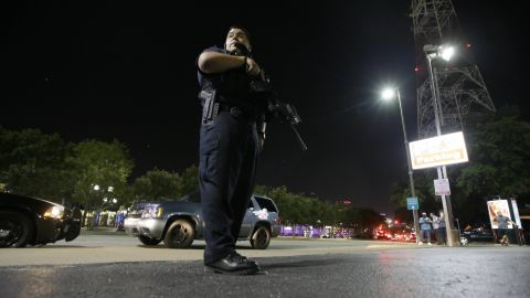 Dallas police stand watch after the shootings.