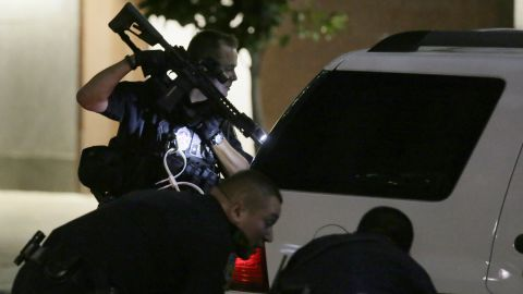 Dallas police check a car after detaining a driver.