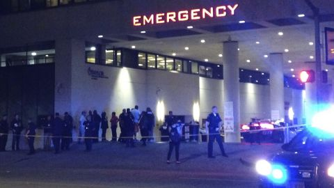 Police and others gather at the emergency entrance to the Baylor University Medical Center.